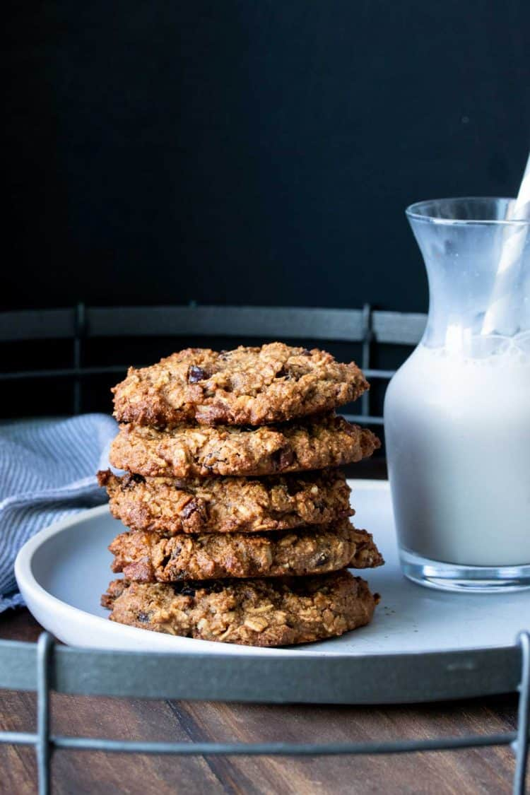 A stack of oatmeal raisin cookies on a grey plate