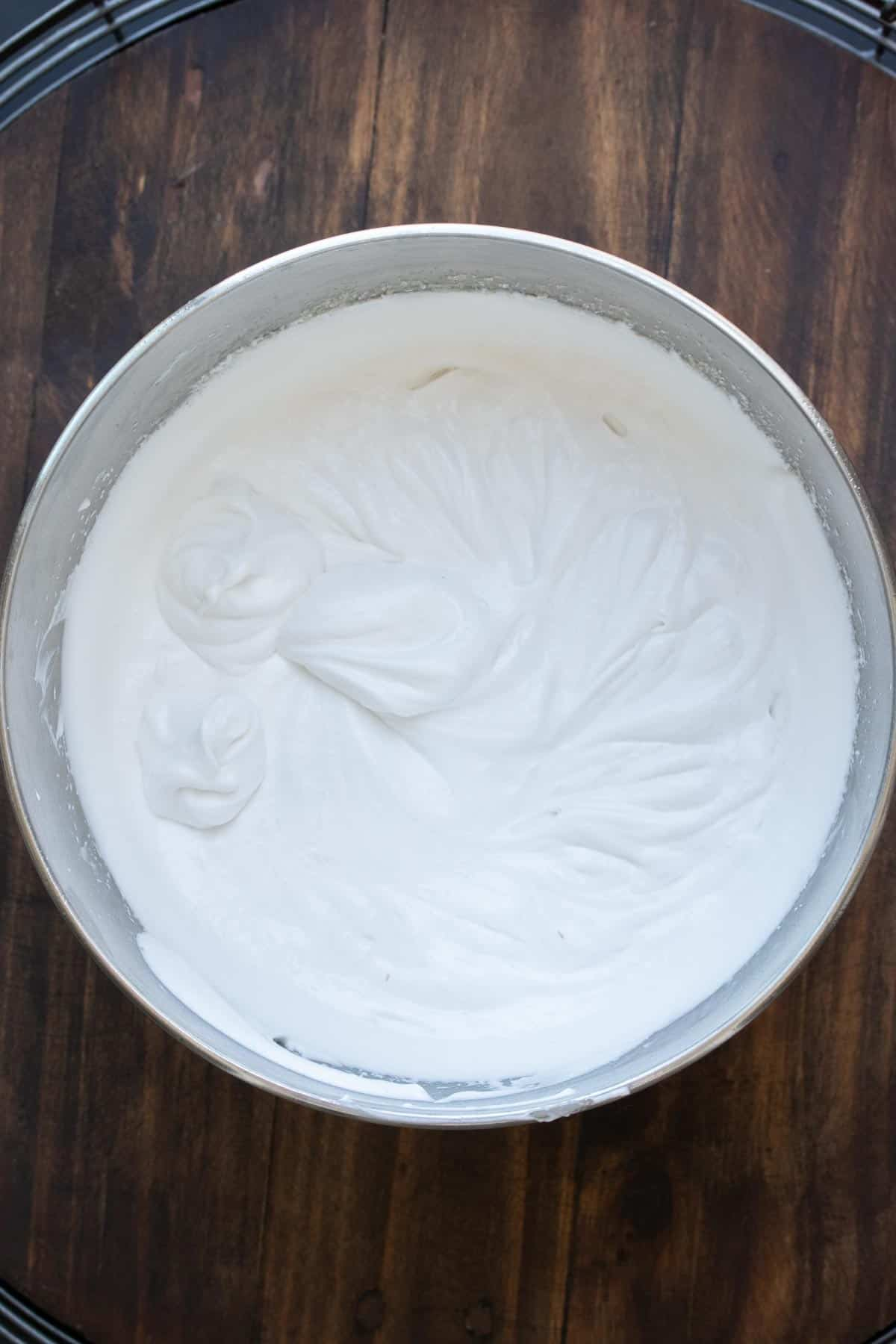 Top view of coconut whipped cream in a silver bowl