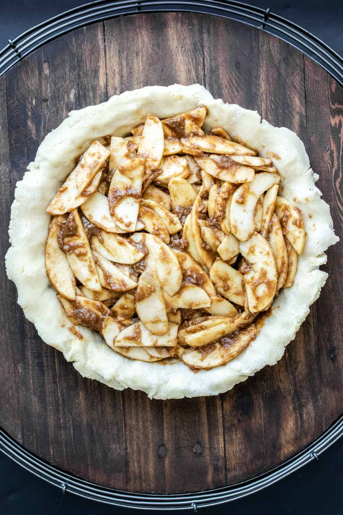 Raw pie crust filled with apple pie filling