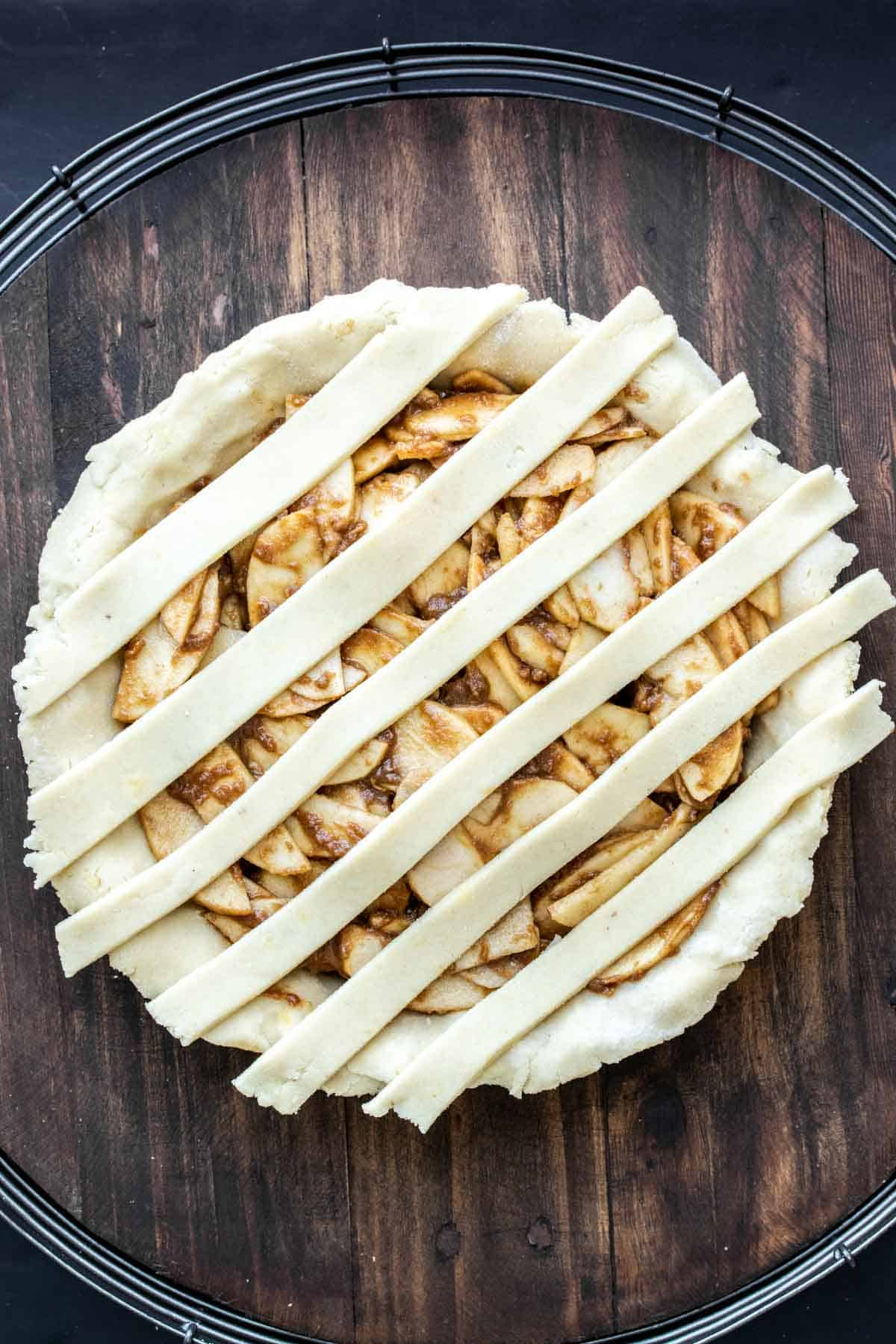 Raw apple pie with strips of pie dough on top