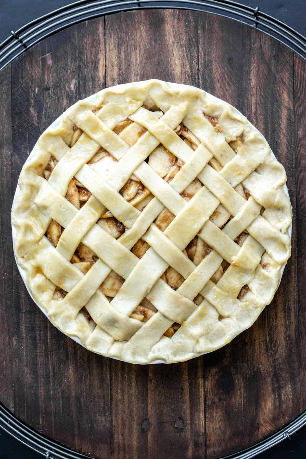 A whole raw lattice topped apple pie