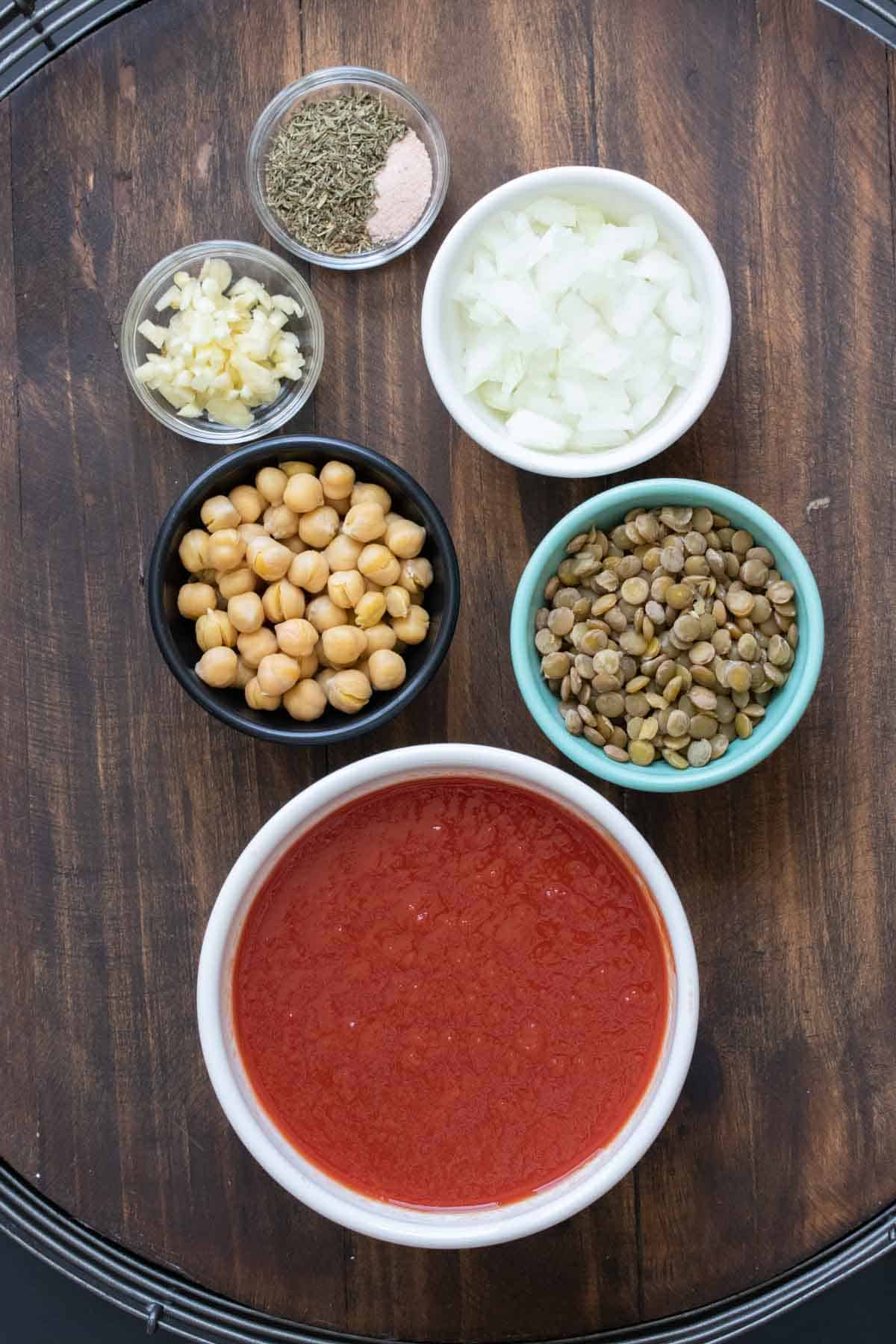 Bowls of ingredients to make bean based bolognese sauce