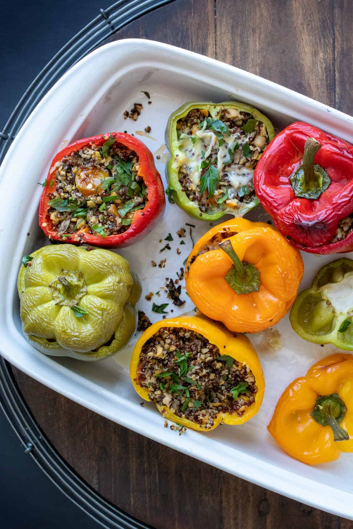 Top view of stuffed peppers in a white baking dish