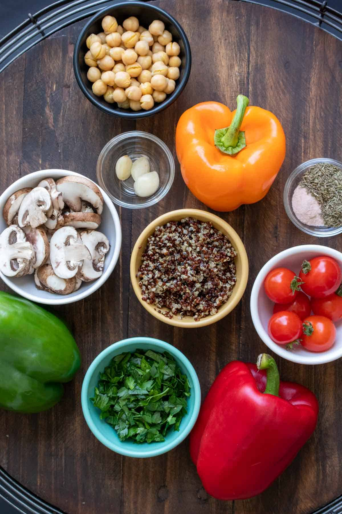 Ingredients used for stuffed peppers in bowls and on the wooden table