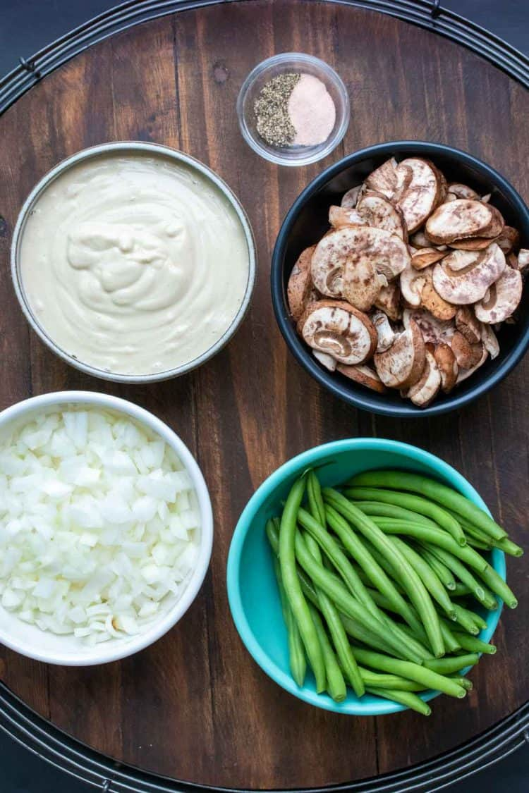 Bowls filled with ingredients for green bean casserole