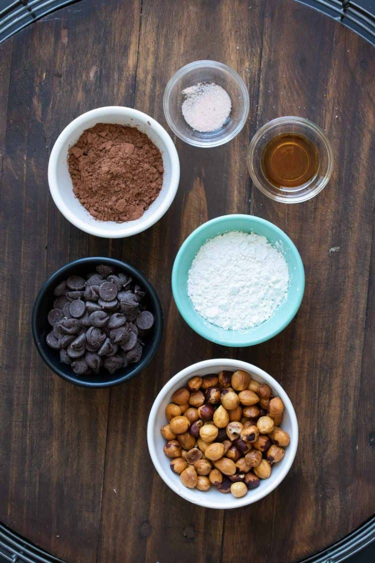 Ingredients to make homemade Nutella in different colored bowls
