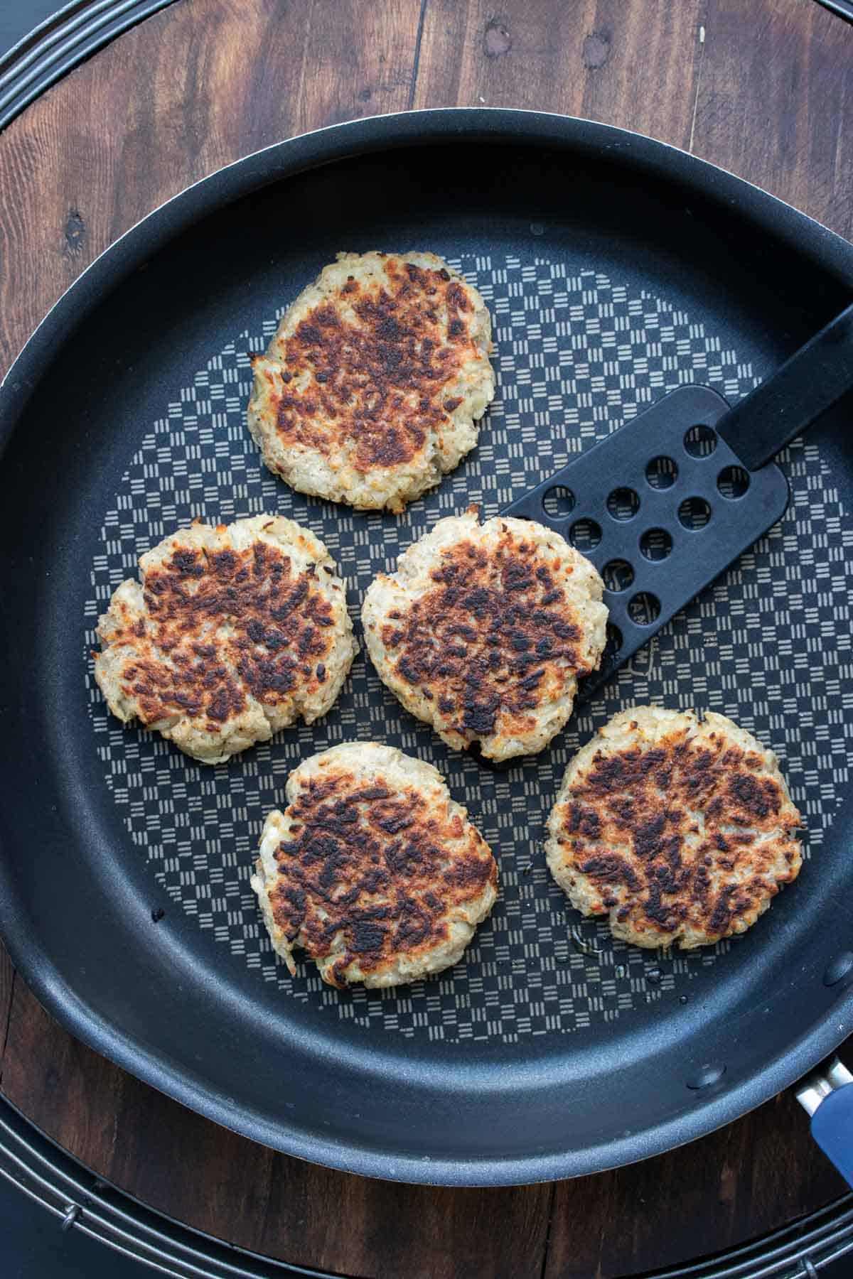 Potato pancakes being grilled on a pan