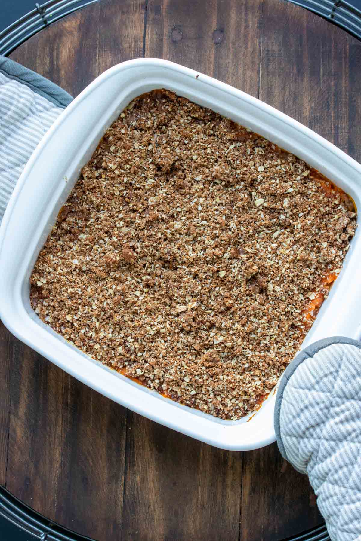 White baking dish with a baked sweet potato casserole in it