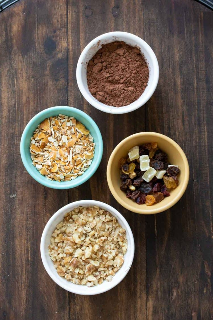 Bowls with different toppings for chocolate truffles