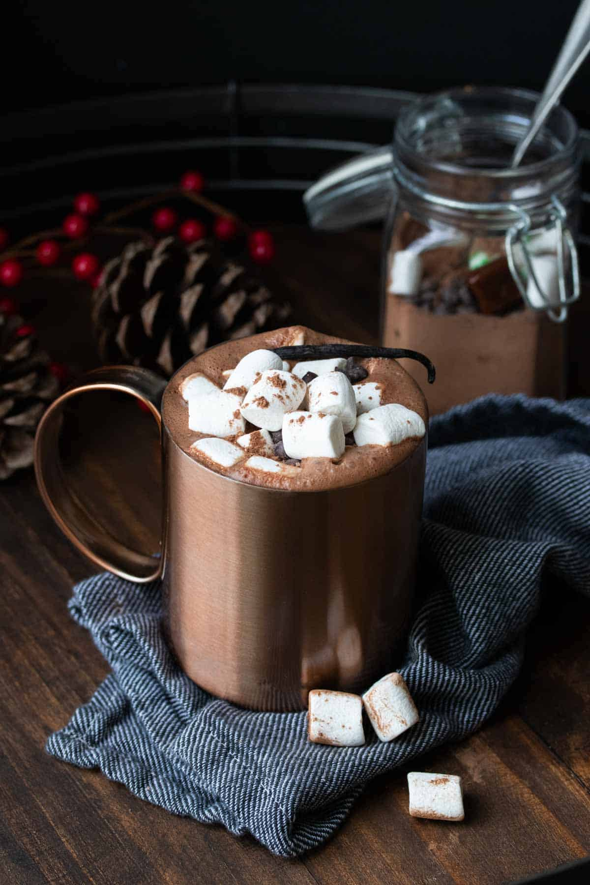 Copper mug with hot chocolate topped with marshmallows