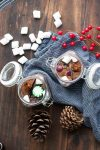 Top view of glass jars filled with hot cocoa mix and candies