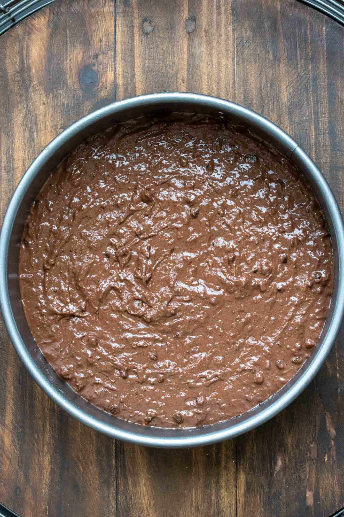 Raw chocolate cake batter in a round pan
