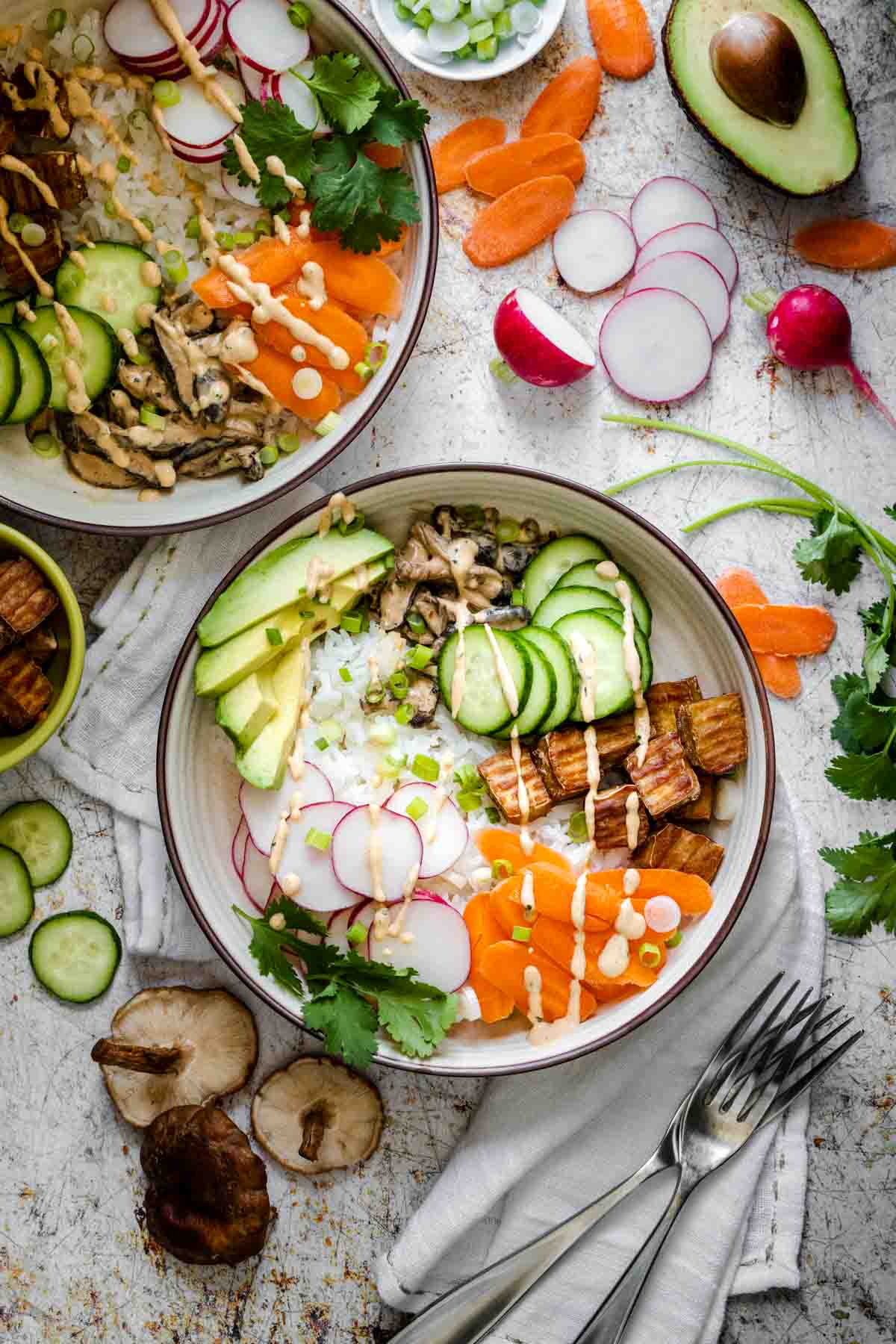 Top view of a sushi bowl filled with veggies on a wooden surface