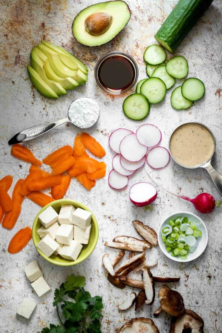 Different color bowls filled with ingredients to make a veggie sushi bowl