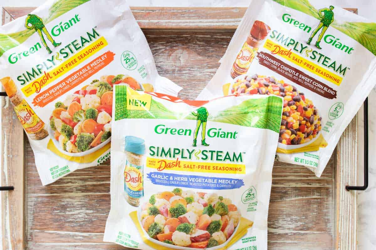 Three white packages of frozen veggie mixes from Green Giant