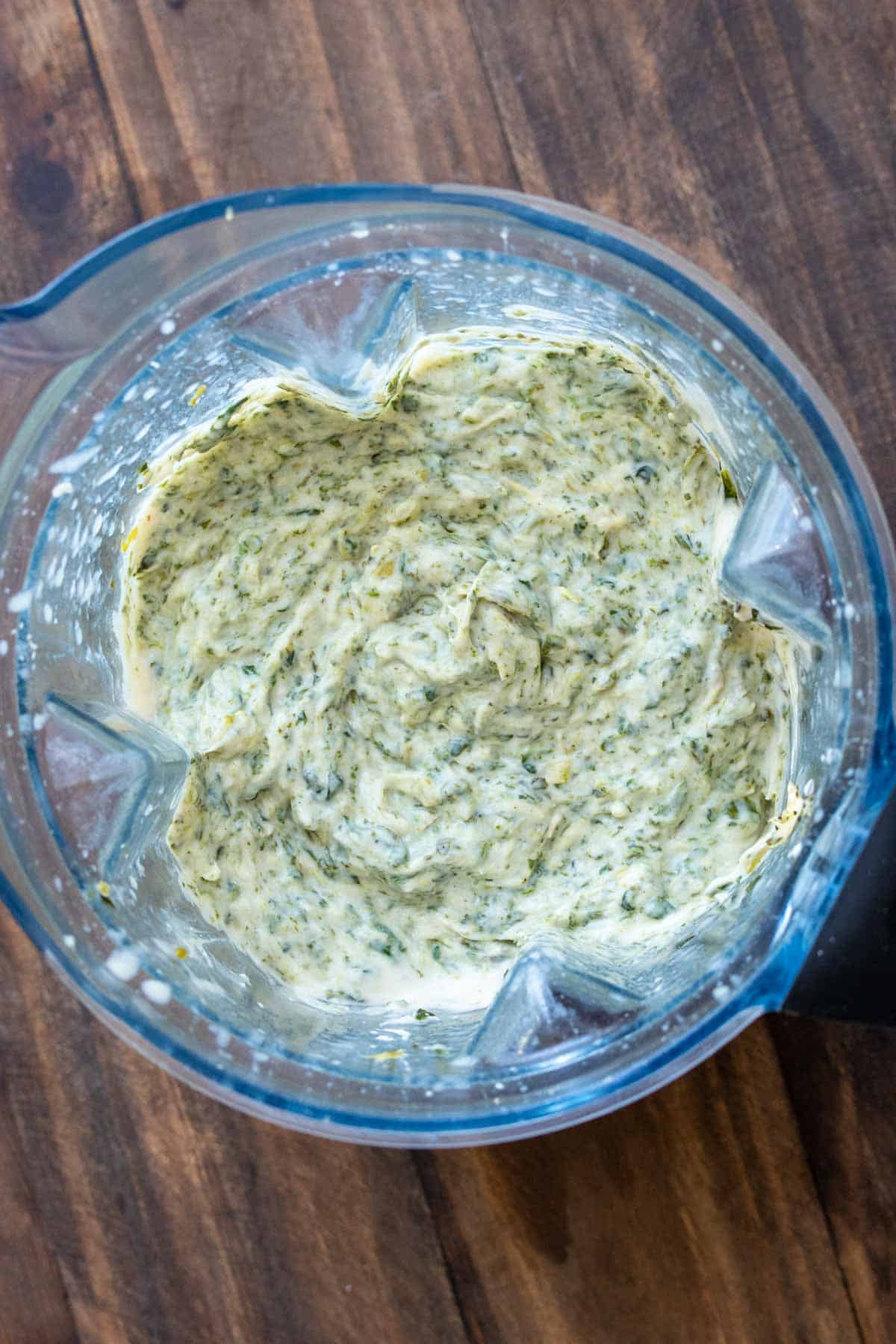 Top view of spinach artichoke dip in a blender