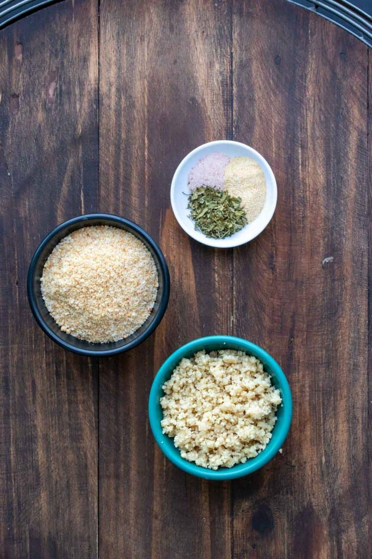 Bowls with ingredients needed to make a parmesan breadcrumb topping