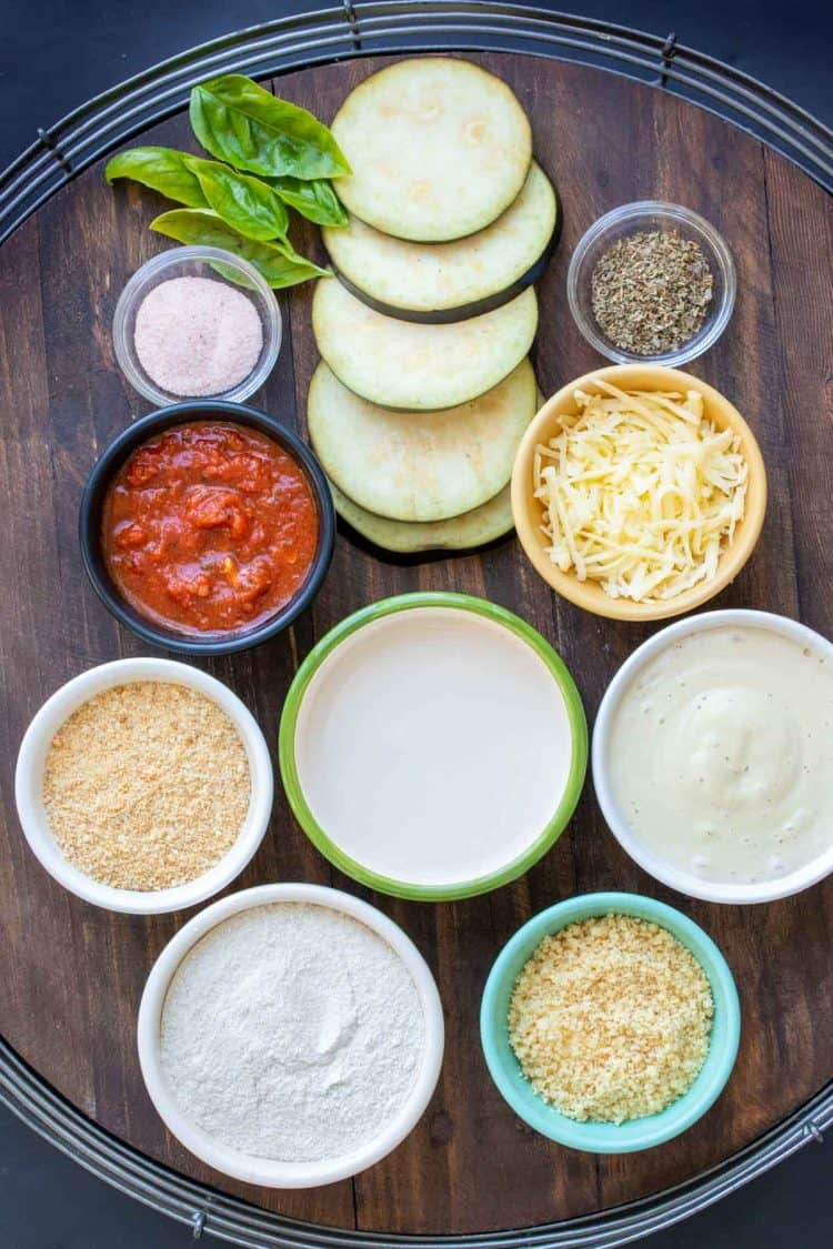Different colored bowls with ingredients to make a dairy free eggplant parmesan recipe