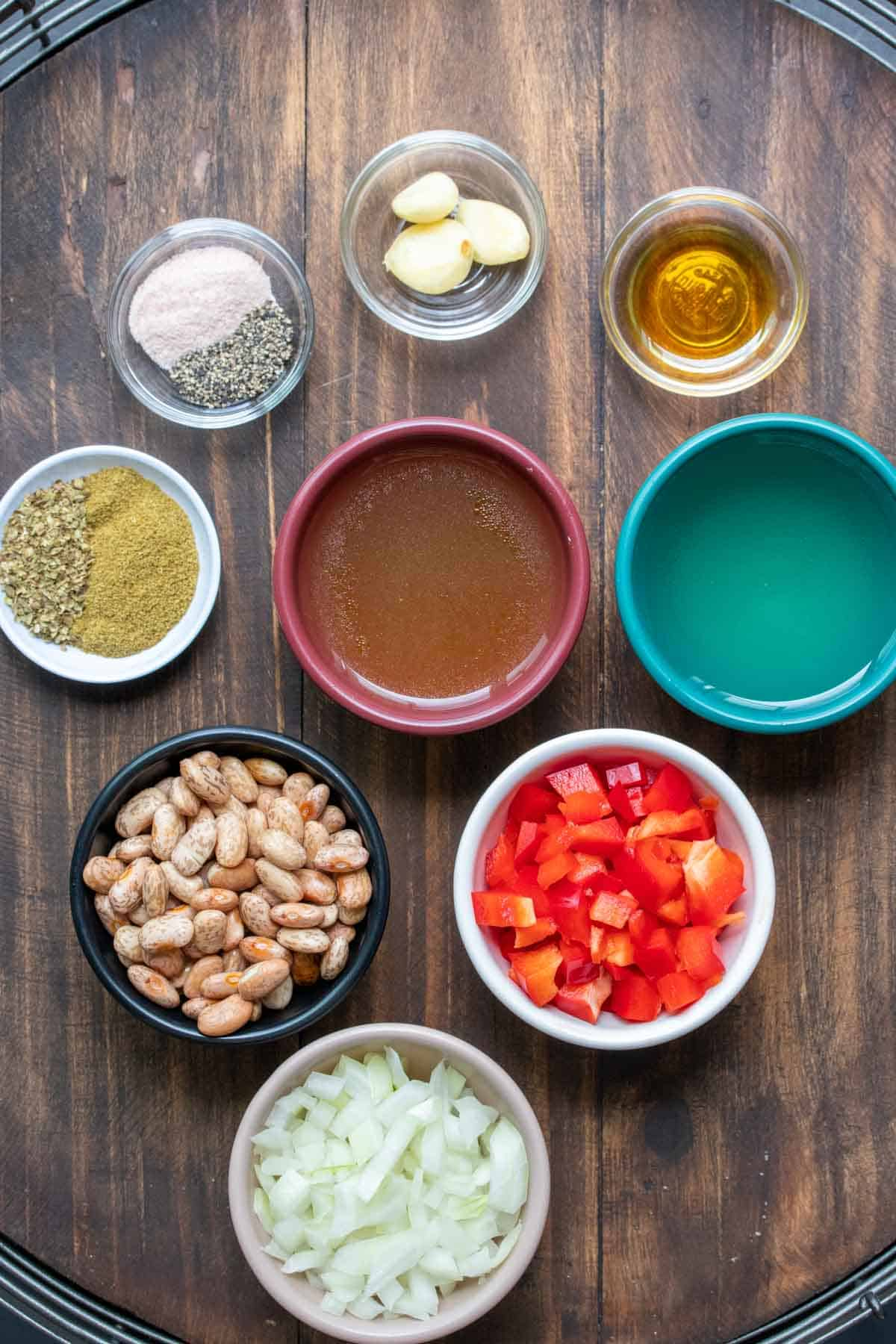 Different colored bowls filled with ingredients to make homemade pinto beans