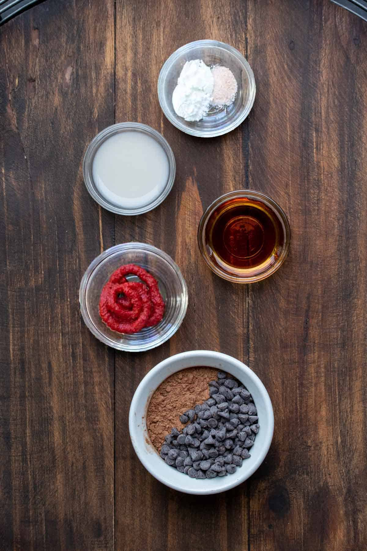 Bowls with ingredients to make a chocolate mug cake