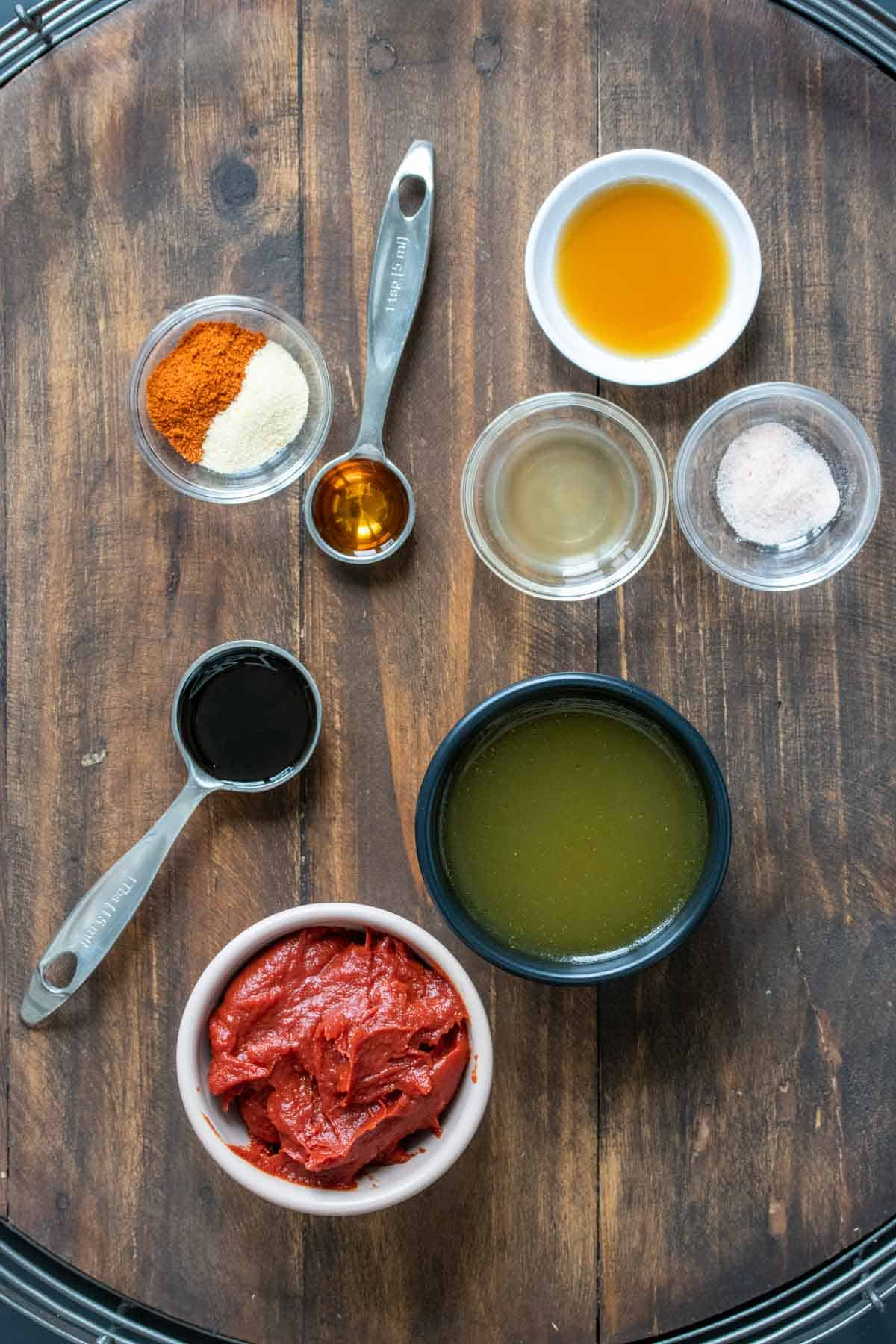 Different color and sized bowls with ingredients to make homemade bbq sauce