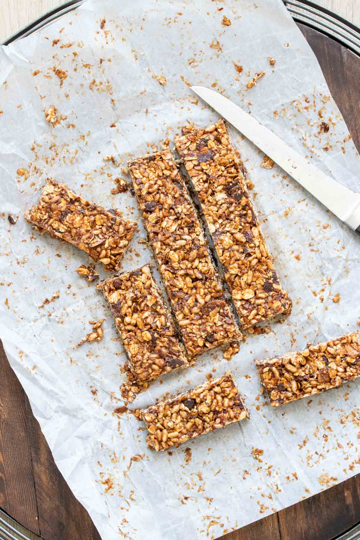 Homemade granola bars cut on a piece of parchment paper