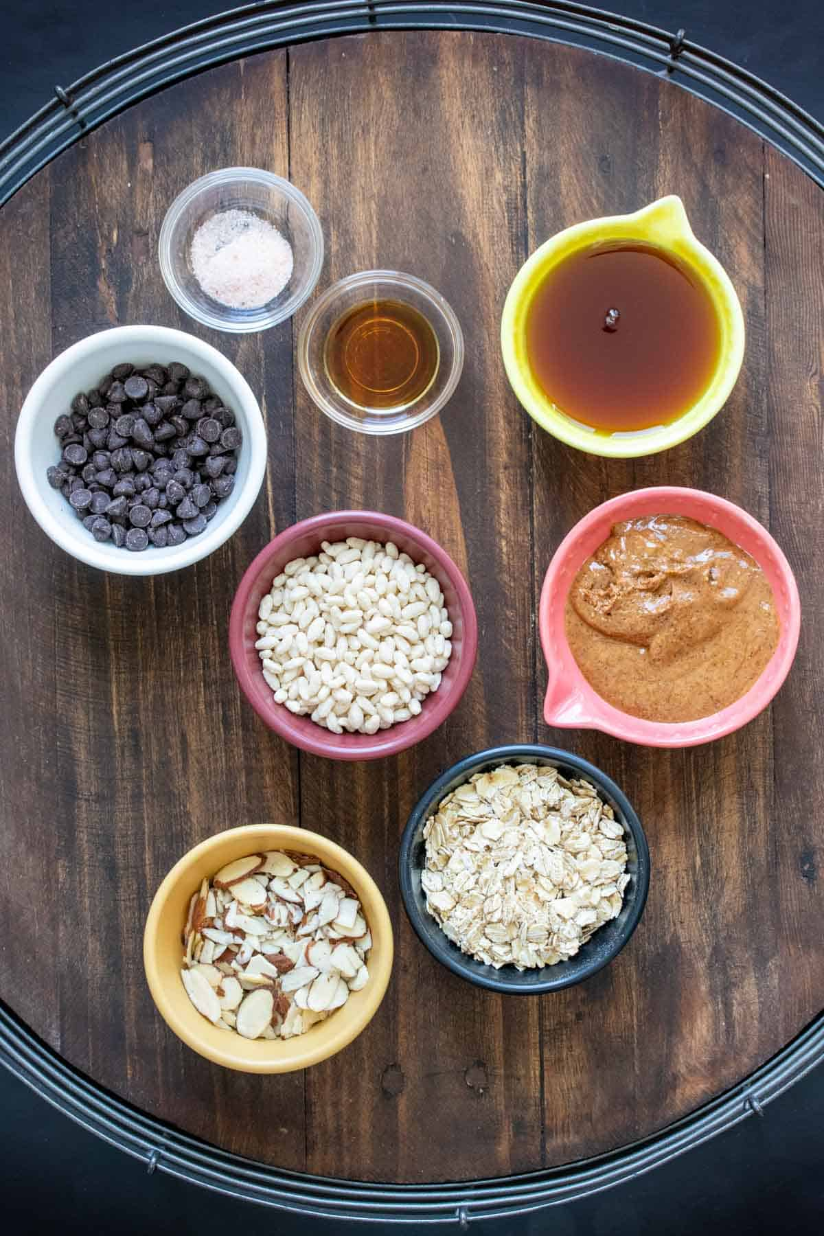 Bowls with ingredients needed to make homemade granola bars
