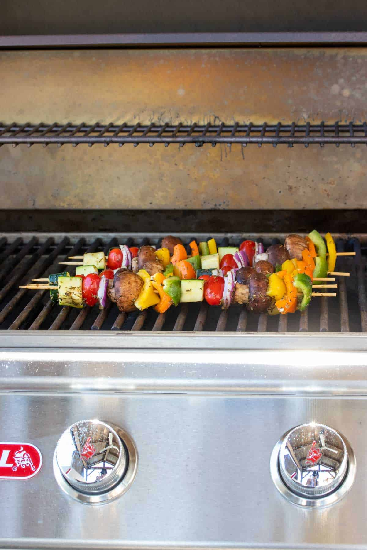 Veggie kabobs being grilled on an outdoor grill